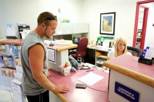 LLCC-Litchfield staff working with student