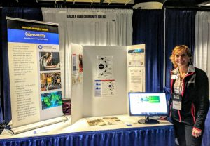 Dr. Carmen Allen at LLCC booth at NSF/ATE Conference