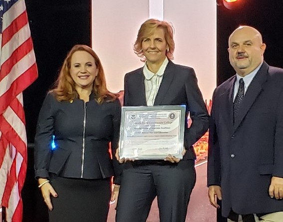 Dr. Carmen Allen receives the CAE 2Y designation certificate from National Security Agency representatives.