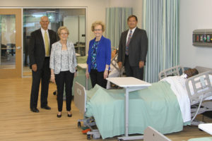 Ken Elmore, Dr. Charlotte Warren, Marsha Prater and Ed Curtis discuss state-of-the-art features in a nursing lab of the new LLCC Nursing Education Center