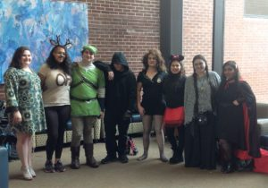 A group of students posing for a photo dressed in their Halloween costumes.