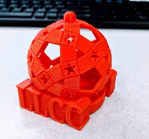 Picture of a red 3D printed LLCC ornament