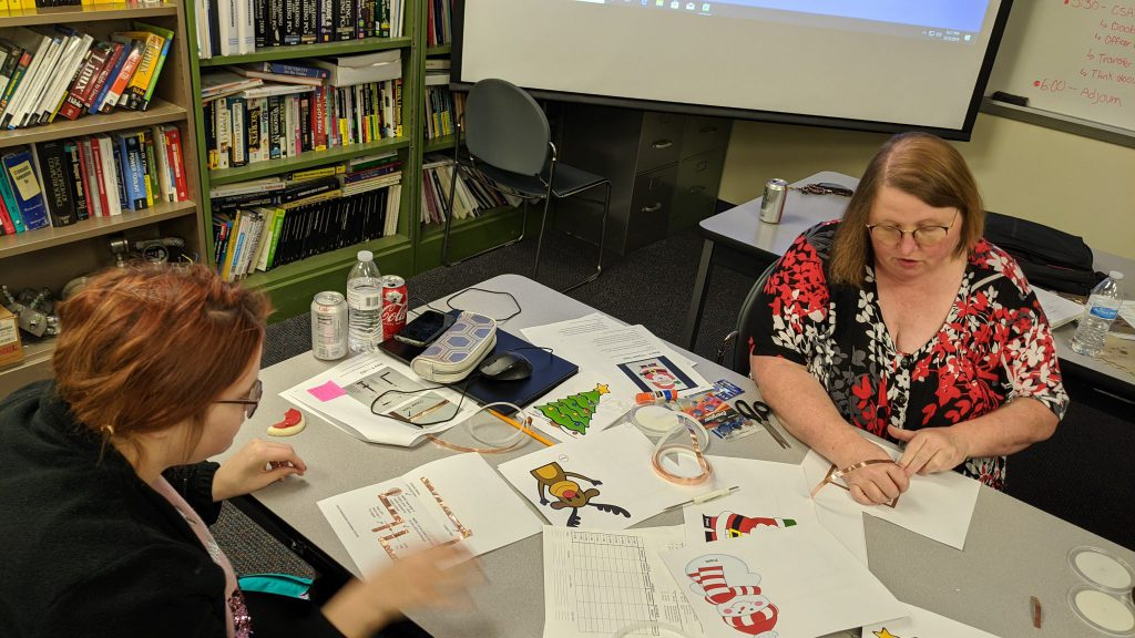 Picture of Advisor Caughey demonstrating holiday card creation