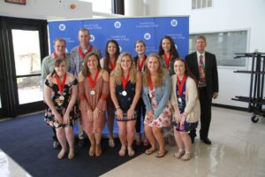 A group photo of students shown with their awards from the Student Recognition Ceremony
