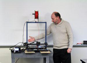 Picture of Professor Sidener describing a 3D printer